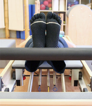 pilates toe socks on the equipment